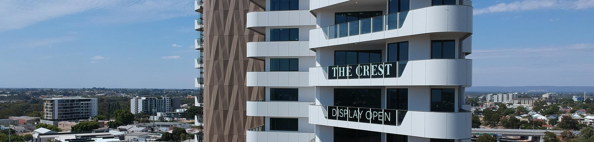 gold facade completed at crest apartments in burswood