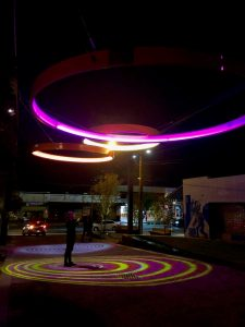 3 coloured DENMAC rings at night at North Perth Common